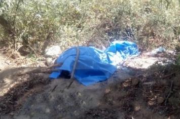Encuentran bolsas con restos humanos y una narcomanta en Puebla